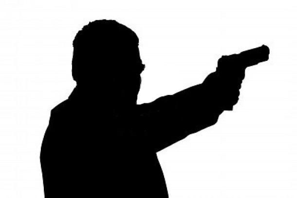 Man-Holding-Gun-1